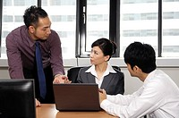 Business executives discussing in an office (thumbnail)