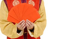 Close_up of a man holding red envelopes
