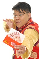 Man holding a red envelope of Chinese currency