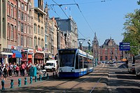 Trams in the Damrak, Amsterdam, The Netherlands