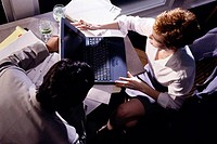 High angle view of a businessman and a businesswoman working on a laptop