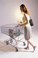 Young woman pushing a shopping cart