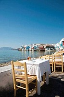 Empty tables and chairs in a sidewalk cafe, Mykonos, Cyclades Islands, Greece