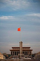 Low angle view of a Chinese flag in front of a monument, Tiananmen Square, Beijing, China