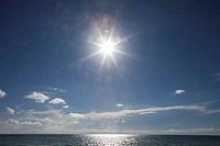 Sun shining over the ocean, Miami Beach, Florida, USA