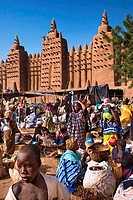 People at market near a mosque, Great Mosque, Djenne, Mali