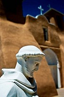 Statue in front of a church, Church Of San Francisco De Asis, Ranchos De Taos, New Mexico, USA