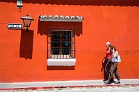Tourists walking on a sidewalk, Antigua, Guatemala
