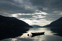 Reflection of fishing boat in fjord, Norway