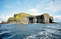 Basalt rock columns of the island of Staffa, Inner Hebrides, Scotland  Entrance to Fingal's Cave on right side