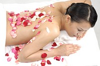 Close_up of a woman lying in spa