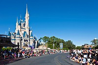 Park guests line the street waiting for 'A Dream Come True' parade at the Magic Kingdom in Disney World, Kissimmee, Florida