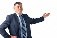 Happy successful businessman pointing to a background