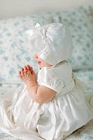 Baby girl dressed for baptism