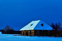 Snow covered farmhouse at night, Alberta, Canada