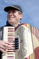 Happy Hispanic musician providing wonderful accordion festival music  Cinco de Mayo Fiesta St Paul Minnesota USA