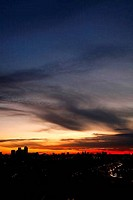 Sunset over the East End with panoramic views towards Canary Wharf and the City of London in the far distance, UK