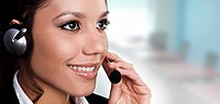 isolated portrait of a beautiful helpdesk or support line operator answering a call. isolated portrait of a beautiful helpdesk or support line operato...