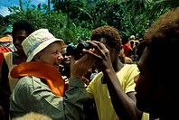 Solomon Islands, Nendo Island, Tourist Showing Native Boy How To Use Binoculars