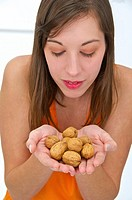 Young woman holding a handful of nuts
