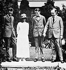 CALVIN COOLIDGE & FAMILY.Calvin Coolidge, 30th President of the United States, photographed at the edge of the White House lily pond with First Lady G...