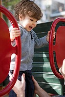Toddler boy playing on playground