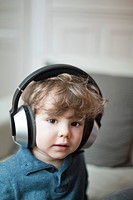 Toddler boy wearing headphones, portrait (thumbnail)