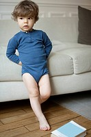 Little boy leaning against sofa, portrait