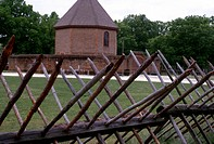 COLONIAL WILLIAMSBURG.The reconstructed octagonal magazine at Williamsburg, Virginia, surrounded by a wall and fence. The original building was constr...