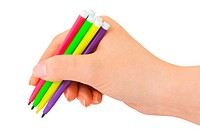 Hand with multicolored pens
