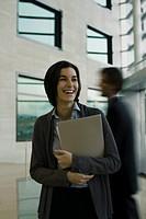 Businesswoman laughing, portrait