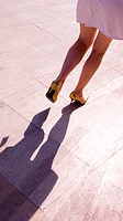 Woman with golden shoes,