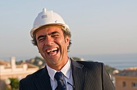 laughing businessman wearing hard hat