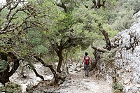 Greece, Crete, Mount Ida, Zaros, Rouvas Gorge, Mature woman hiking near gorge