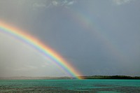 Rainstorm and rainbow near Manta Ray Bay Resort on the island if Yap, Federated States of Micronesia.
