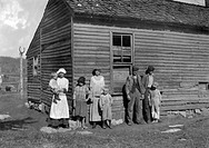 MIGRANT FAMILY, 1916.The Hazel family posing in front of their dilapidated farmhouse. Photographed in Bowling Green (vicinity), Kentucky on 10 Novembe...