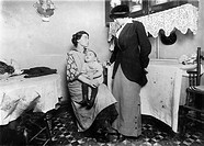 NEW YORK: TENEMENT, 1913.Investigator talking with Isidor Rothandler at 80 Ridge Street, New York City. Photographed on 16 September 1913 by Lewis Hin...