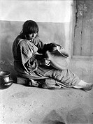 PUEBLO POTTER, c1905.Female potter of the Santa Clara pueblo in New Mexico. Photograph by Edward Curtis, c1905.