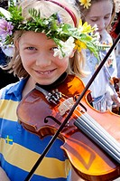 Cute young girl playing the violin for Midsommar Celebration at the Swedish Institute  Minneapolis Minnesota MN USA