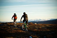 Two men riding bicycle on mountain