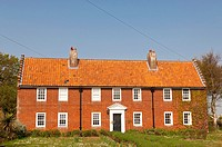 A red brick house at Walberswick in Suffolk , England , Britain , Uk