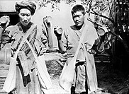 CHINA: CHEFANG, c1940.Two Chinese workers holding up cans with holes punched in them for dusting crops with the pesticide 'Paris green' by hand, in th...