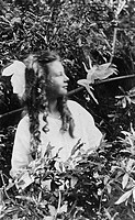 FAIRY HOAX, 1920.Frances Griffiths and a leaping fairy, in a photograph made in 1920 by her cousin Elsie Wright with a paper cutout.