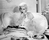 JEAN HARLOW (1911-1937).American film actress. As Kitty in the 1933 film 'Dinner at Eight,' adapted from George S. Kaufman and Edna Ferber's play of t...
