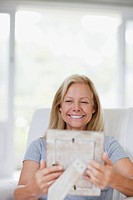 Woman looking at picture frame