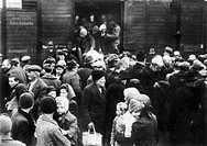 CONCENTRATION CAMP: ARRIVAL.The arrival of victims at a concentration camp during World War II.