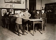 HINE: NEWSBOYS, 1909.Newsboy playing billiards at the United Workers Boy's Club in New Haven, Connecticut. Photograph by Lewis Hine, March 1909.