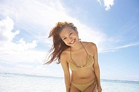 Portrait of young woman standing in water, Guam , USA