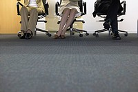 Legs of businesspeople having a meeting