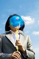 Businesswoman holding a pinwheel